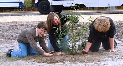 kids-planting, rain garden