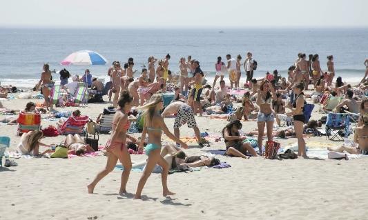 people on beach, tourism, economiy