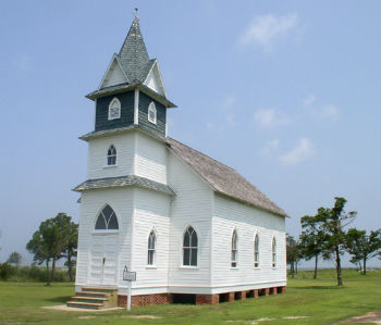 No one lives on Portsmouth Island, but past residents' descendants trek there to decorate the former community's church, homes and graves during Old Christmas. Photo: Wikipedia Commons