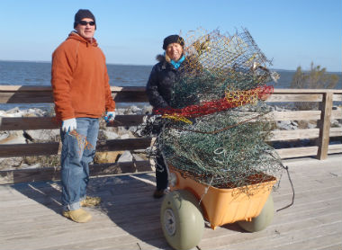 Local volunteers Chuck Lycett and Mary Ann Hodges collected these derelict crab pots on the north end of Roanoke Island. Photo: staff