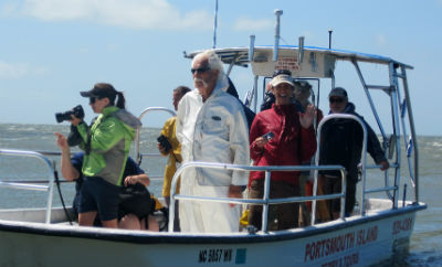 Commercial fisherman James Barrie Gaskill takes interns on a water tour of Portsmouth Island.