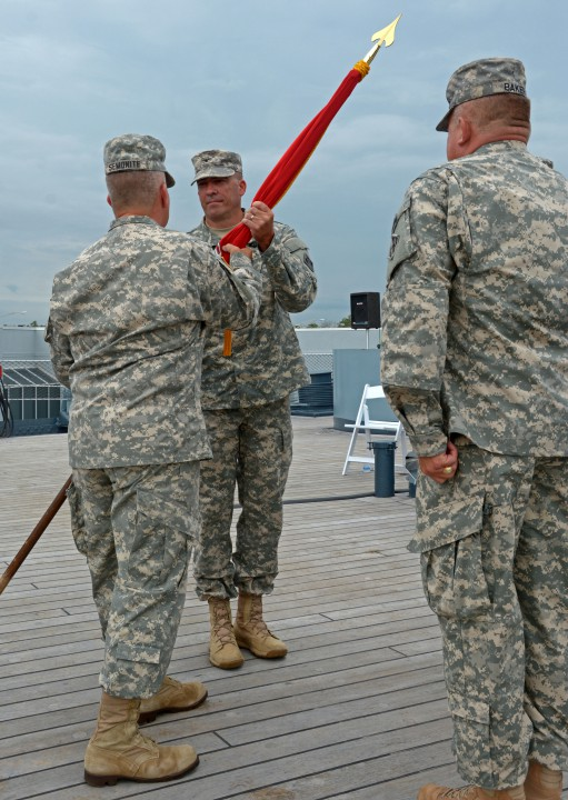 Col. Kevin Landers, center, the incoming Wilmington District commander, receives the Army Corps of Engineers flag from Brig. Gen. Todd Semonite, the Corps' deputy commanding general, as the outgoing commander, Col. Steve Baker, stands at attention. Photo: Army Corps of Engineers