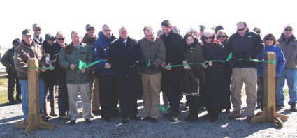 State officials and locals folks are obviously cold when they cut the ribbon for the new boat ramp in Manns Harbor.  Photo: Angie Daniels, Outer Banks Chamber of Commerce