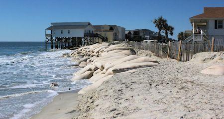 Sandbags to protect beachfront houses line the east end of Ocean Isle Beach. Photo: Kirk Ross