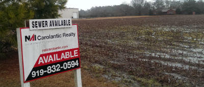 This 21-acre tract on N.C. 24 in Carteret County is being advertised as having sewer available. Photo: Frank Tursi, Coastal Review Online