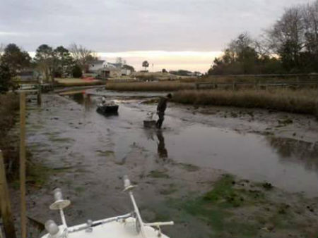 Eddie Privette now has to lug his oysters across the  mud to his dock on Hawkins Creek. Photo: Brad Rich