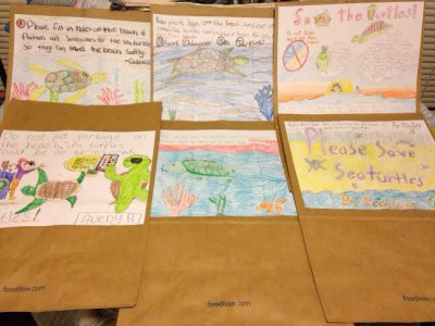 Students at Stokesdale Elementary School in Stokes County drew these pictures on grocery store bags, which will be distributed to shoppers in the area to raise awareness for sea turtles. The kids also donated their allowance, ice cream money and pocket change – more than $200 – to NEST. Photo: NEST