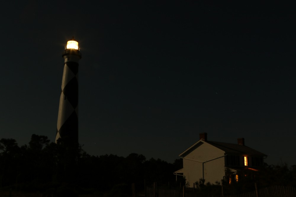 Once the moon was high in the sky it showered everything in a bright silvery glow. A light left on in the old keepers quarters made the house seem alive, maybe the ghosts from the past were enjoying the night.