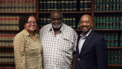 Harriett Hurst Turner, left, and John Hurst, center, are pictured with Charles Francis, the attorney who represented them in an case that ended in a land sale that earned them $10.1 million and added 290 acres to Hammocks Beach State Park.