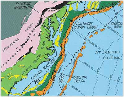 Geologic framework of the mid-Atlantic continental margin shows the following relevant features: Appalachian and Piedmont Provinces (pink), Coastal Plain Province (light green), exposed rift basins on land (black), rift basins buried beneath marine sediments (yellow), and deep-water offshore basins (dark green and western orange strip). The black dashed lines, from left to right, represent the -200 meter (-667 foot), -2,000 meter (-6,667 foot), and -4,000 meter (-13,333 foot) contour below mean sea level. Graphic: Report Of The Governor's Scientific Advisory Panel On Offshore Energy