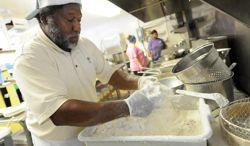Andy Gaus works in the kitchen at Calabash Seafood Hut. Photo: Allison Ballard