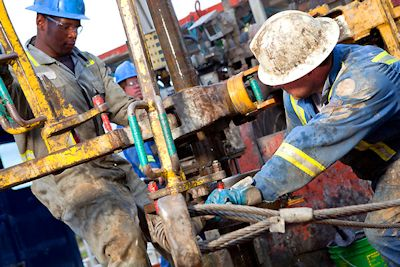 Roughnecks are the grunts of an oil platform workforce, which also includes scientists, accountants, cooks, welders, plumbers and a host of other skills. Photo: Oildrilling.com