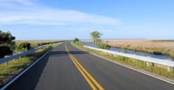 Vast expanses of marsh and open road mark the Cedar Island National Wildlife Refuge. Photo: Catherine Kozak