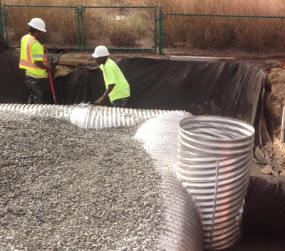 Workers with Coastal Stormwater Services install an innovative infiltration system to divert polluted stormwater runoff away from an outfall pipe leading into Banks Channel along Waynick Drive in Wrightsville Beach. Photo: N.C. Coastal Federation