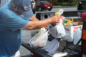 Bill Hadesty, a retired accountant, does a lot of the weighing at Holden Beach. Photo: Hannah Miller