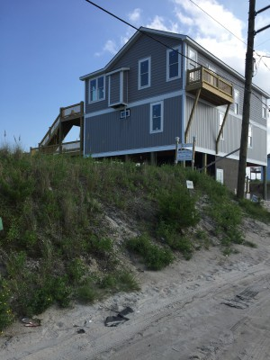 This newly constructed home sits on a lot amid an oceanfront stretch of properties at the southern end of Topsail Beach. The homeowners received permits to build before the town board in June amended Topsail Beach's dune permit ordinance, which prohibits the removal of more than one cubic yard of sand from the dune system. Photo: Trista Talton