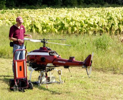 Pilot and mechanical engineer Kevin Kochersberger, an associate professor in the Virginia Tech College of Engineering, readies a 200-pound helicopter he engineered to fly autonomously to determine whether drones can gather data useful for managing crops. Photo: Virginia Tech