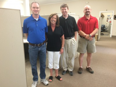 Fowler, second from left, poses with her staff, Shannon Jenkins, Andrew Haines and J.D. Potts. Photo: Mark Hibbs