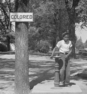 A segregation sign can be seen next to a drinking fountain on the county courthouse lawn in Halifax, N.C. Photographed by John Vachon, April 1938. Courtesy of the Prints and Photographs Division, Library of Congress, Washington, D.C.