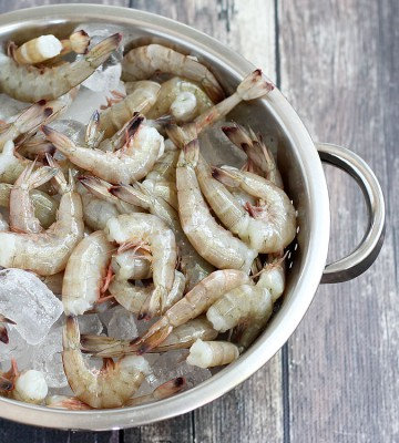 Fresh shrimp are recognized by having firm bodies that are still attached to their shell. You should always avoid shrimp with any sign of odor or pink color. Photo: Amy Brinkley