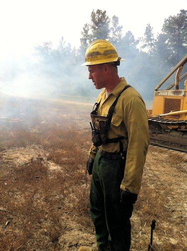 Kenneth Shugart works a fire at a game lands in Bladen County to restore a longleaf pine forest. Photo: Allison Ballard