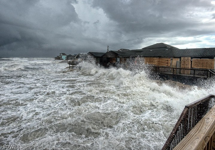 Storm waves Sunday batter buildings in Buxton. Photo: Don Bowers, Island Free Press.