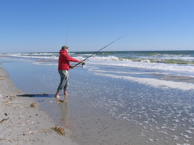 Don Roberts of Stow, Ohio, casts into the surf near the Green Street access on the south end of the beach. Photo: Mark Hibbs, Coastal Review Online