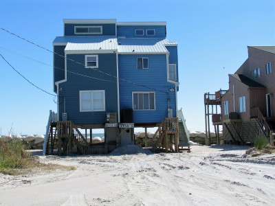 A North Topsail Beach oceanfront homesite shows the evidence of overwash that breached the dunes during the coastal storm earlier this month. Photo: Mark Hibbs
