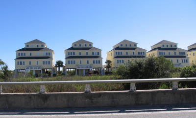 A row of homes occupy beside a bridge on New River Inlet Road where a temporary inlet opened up during storms in the 1990s. Photo: Mark Hibbs, Coastal Review Online