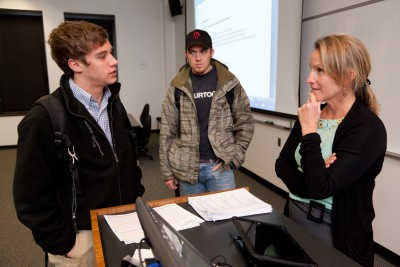 Susan Wilde, a professor at the University of Georgia, talks to her students after class. Photo: University of Georgia.