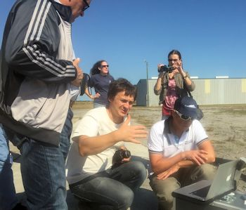 Russian environmental activists watch a demonstration of drones at North River Farms in Carteret County. Photo: N.C. Coastal Federation