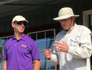 """Greg """"Rudi"""" Rudolph, left, and Charles """"Pete"""" Peterson talk about the effects of rising seas during a 2015 event in Onslow County. Photo: Brad Rich, Tideland News"""