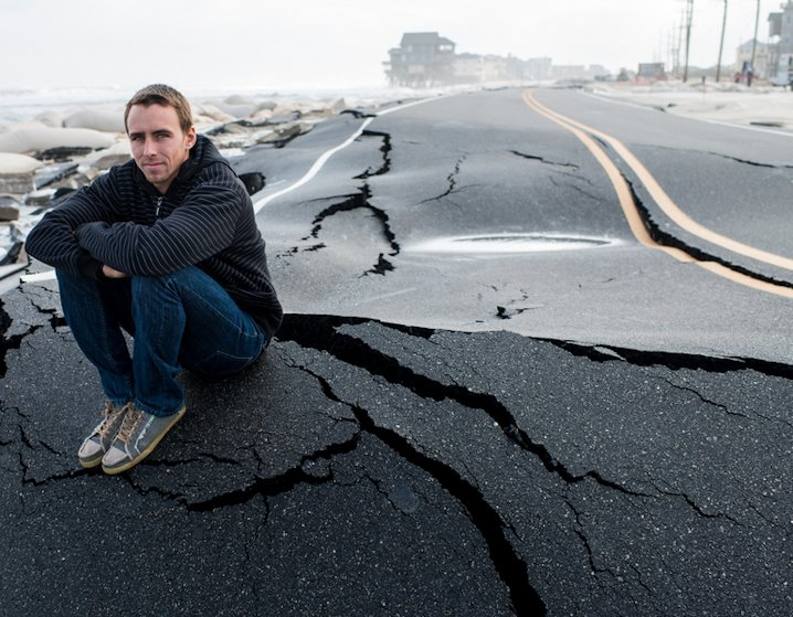 Professional surfer and native, Brett Barely, surveys the damage of his home and playground after Hurricane Sandy.
