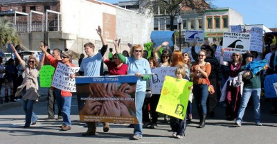 Protesters representing the Stop Titan Action Network parade. Photo: Stop Titan Facebook Page