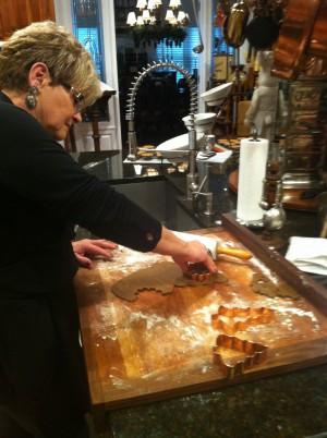 Karen Moshoures rolls the dough for her gingerbread cookies. Photo: Allison Ballard