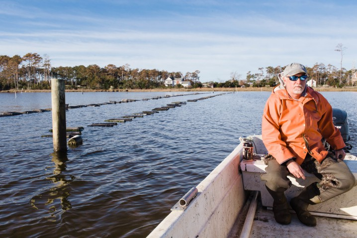 Ken Styron heads out to his oyster beds off Cedar Island in Carteret County. Photo: Baxter Miller, Bit + Grain