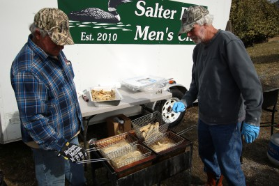 Members of the Salter Path Men's Club fry fish for the feast. Photo: Sam Bland
