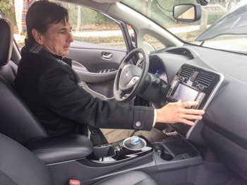 Kent Perry of Greenville Nissan demonstrates the controls of a Nissan LEAF for meeting attendees in New Bern. Photo: Mark Hibbs