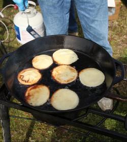 A cook prepares a skillet of pancake cornbread. Photo: Sam Bland