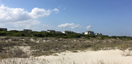 This is about where Holden Beach's proposed terminal groin would be anchored. Homes nestled in Dunescape, a gated neighborhood on the far eastern end of Holden Beach, stand in the background, including the home of Ronda Dixon.Dixon's property is one of two lots the proposed structure may cross.