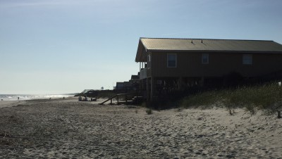 Holden Beach is considering building a terminal groin to protect homes, including this house at the end of McCray Street on the eastern end of the Brunswick County barrier island. Chronic erosion at the eastern end of the island has claimed numerous homes over the decades. Photo: Trista Ralton