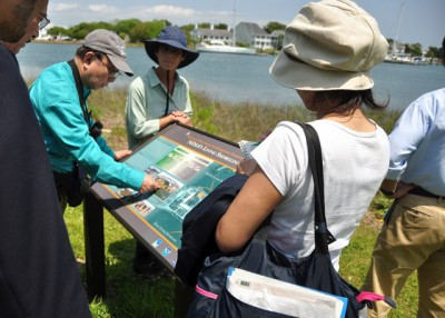 A group from the Japan Ecosystem Conservation Society explores the National Oceanic and Atmospheric Administration's Beaufort lab during a visit to the area last week. Photo: Todd Miller