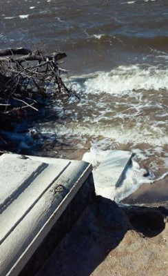 High water and waves have seriously eroded the cemetery and partially exposed some tombs. Photo: Island Free Press