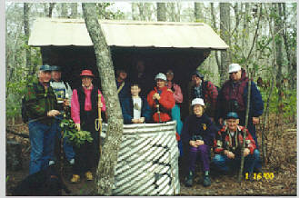 """The wildlife club's subcommittee on """"Nails, Hammers and Slightly Smashed Thumbs"""" designed and built the shelters in Gene Huntman's backyard, then each was partially dismantled and transported to the site for final construction. Photo: Carteret County Wildlife Club"""