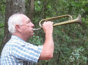 Gene Huntsman uses a bugle as a signal for others building the Neusiok Trail. Photo: Carteret County Wildlife Clun