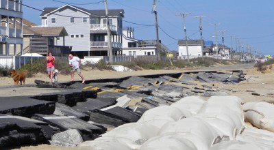 Giants sandbags protected this section of N.C. 12 near Kitty Hawk that was wiped out by a storm last year. Photo: Outer Banks Voice