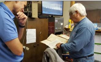 Jamie Rhome talks with Dare County Commissioners Allan Burrus. Photo; Island Free Press