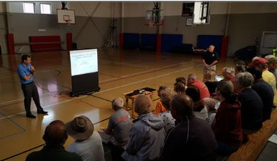 Jamie Rhome talks to a packed house in Buxton. Photo: Island Free Press