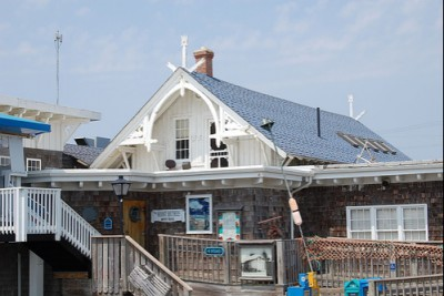The old lifesaving station in Kitty Hawk, now a restaurant, has been moved several times, but is ghost came with it. Photo: Library of Congress image enhanced by Joyner Library, East Carolina University