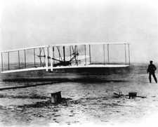 A crew member of the life saving station took this photo of the Wright Brothers' first flight. Library of Congress image enhanced by Joyner Library, East Carolina University.